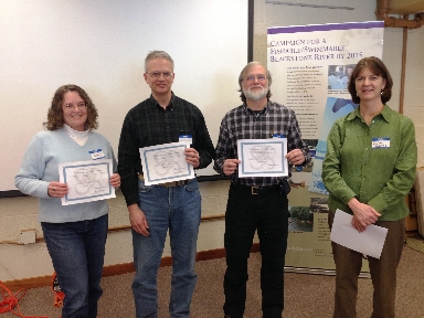 Jane St. Denis, Ken Guertin, and Mike Sperry receiving                   their Certificates of Appreciation from Susan Thomas (far right)                   for volunteering 5-9 years as monitors with the Blackstone River                   Coalition's Watershed-wide Volunteer Water Quality Monitoring Program.