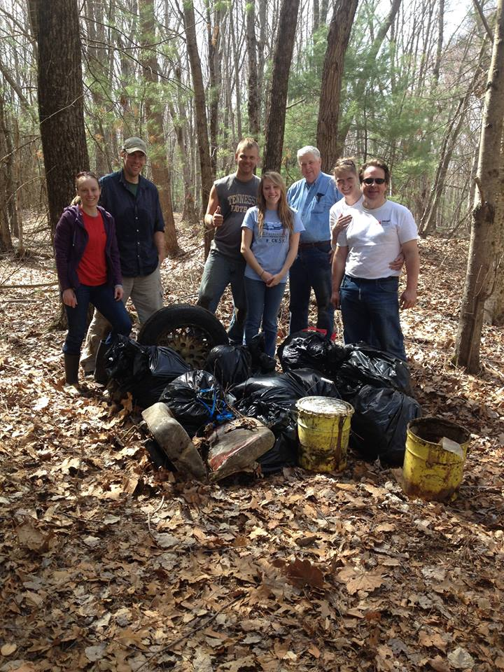 2015 Earth Day volunteers at Plummers Landing with pile of trash.