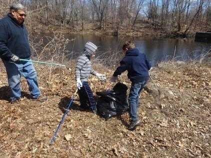 young Earth Day Cleanup volunteers hard at work