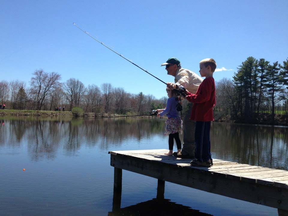 young boy and girl learning to fish.