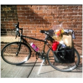 bicycle with groceries in cargo carrier.