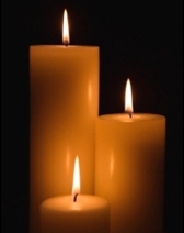 glowing beeswax candles
